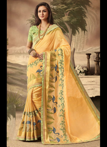Light Orange and Green Embroidered Saree